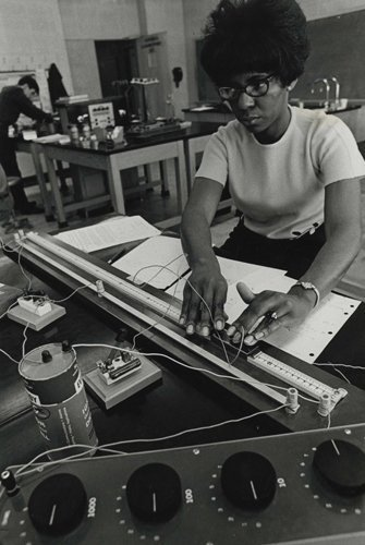 1960s: Student working in a lab.