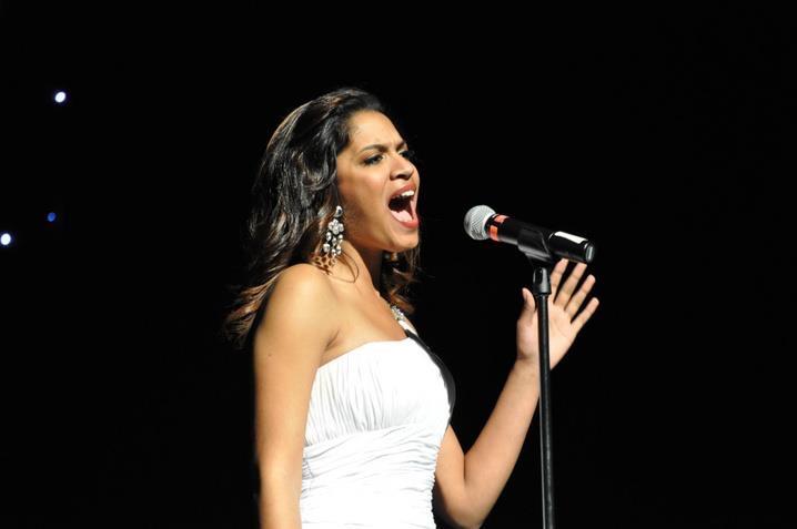 Jasmin Severino singing during the talent portion of Miss UGA