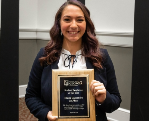 Elaine Cassandra with Student of the Year Plaque