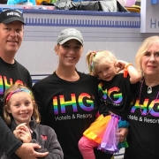 Danielle Derkink (center) with her family at the Atlanta Pride Parade.