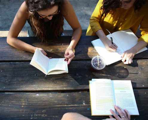 Students reading with coffee.