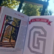 G Book in front of the Arch on UGA's North Campus.