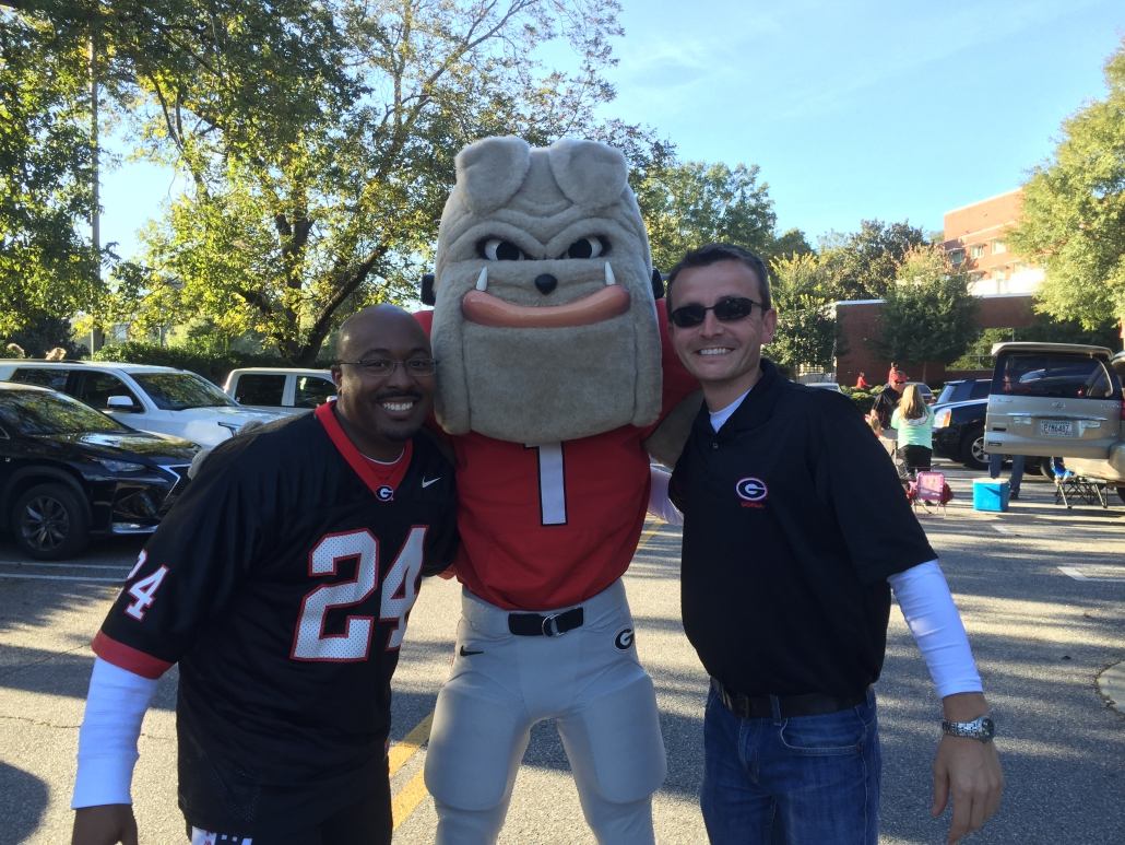Alex Wallace and friend pose with Harry Dawg on a game day