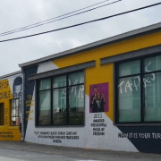 an image of a yellow and white mural featuring John Lewis