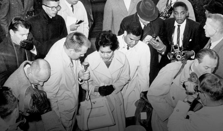 Charlayne Hunter and Hamilton Holmes are greeted by the press as they walk toward the Admissions Office in the Academic Building on Jan. 9, 1961, to enroll as the first African American students at UGA.