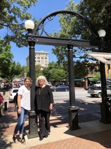 Sandra Derrick (BSHE '76, MED '80) and Anna Schermerhorn '20 pose at the UGA Arch