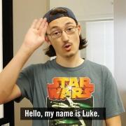 "Luke signing ""Hello"""
