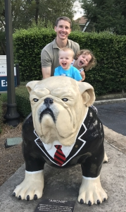 Andrew McKown and children on one of Athens' bulldog statues