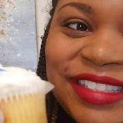 UGA mentor Ansley Booker raises a cupcake in a birthday salute to the UGA Mentor Program