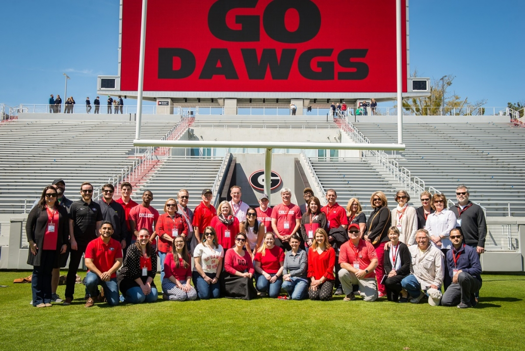 Sanford-Stadium-Group-Pic-on-Field