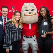 Representatives Aaron Konnick, Samantha Green and Isobel Egbarin from UPS accept the UGA Top 25 Employer Award. (Photo credit: Justin Evans Photography)