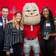Representatives Aaron Konnick, Samantha Green and Isobel Egbarin from UPS accept the UGA Top 25 Employer Award. (Photo credit: Justin Evans Photography)