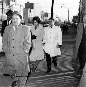 Charlayne Hunter and Hamilton Holmes walk up Broad Street in Athens on Jan. 9, 1961, to enter the UGA campus to become the first African Americans to attend the university.