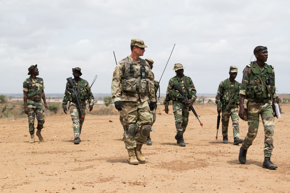 Capt Andrew Murphee walks along side leadership of the Senegalese Army.