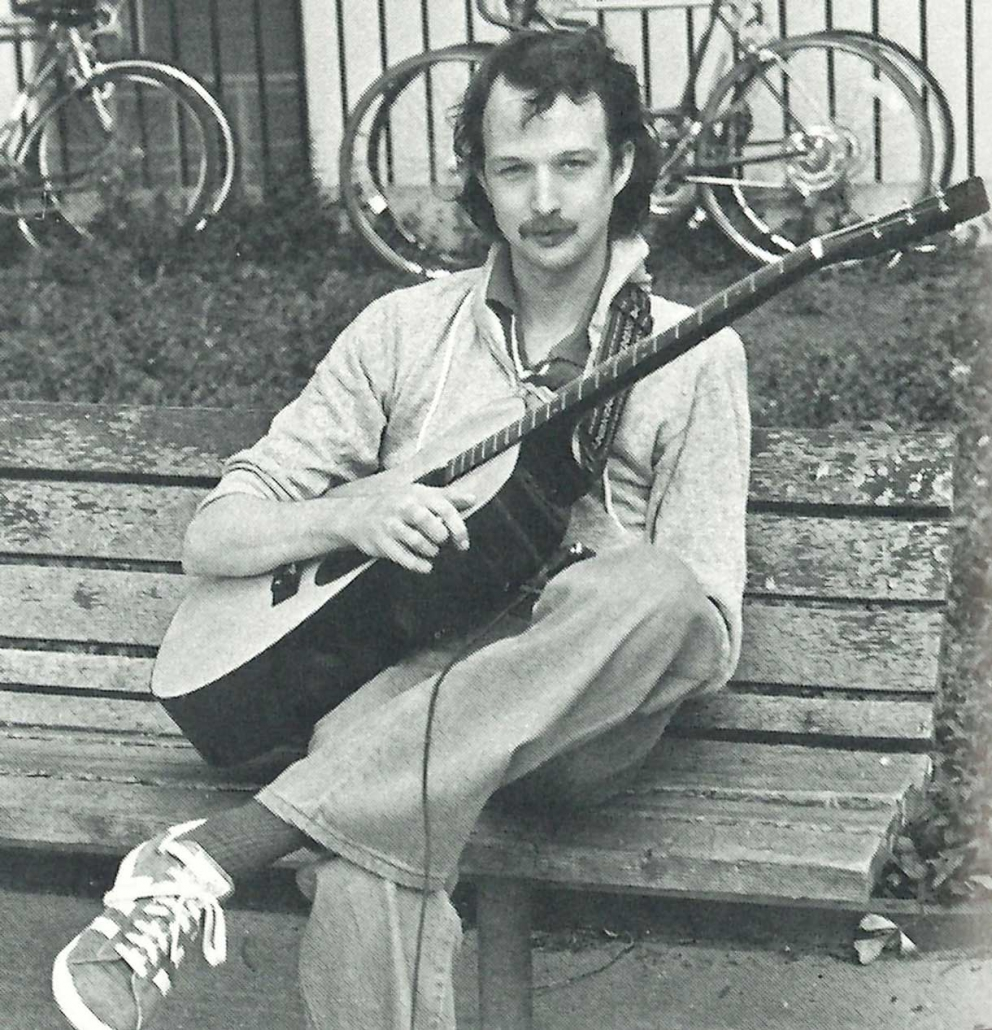 Student playing guitar 1980